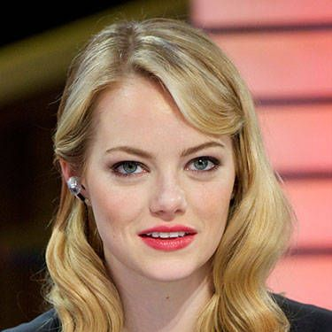 Emma Stone's Old Hollywood siren waves are sure to steam up the season…and they're easy to pull off. Simply separate hair into four or five sections, set on jumbo hot rollers and let cool. Finger-style and sweep one side back in a fun clip.
