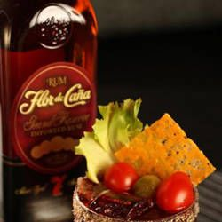 1 ounce Flor de Cana 7 yr rum2 muddled Roma tomatoes1 ounce iceberg lettuce water*1 ounce beef (well reduced)2 tbsp toasted bread crumbs1 tsp dry mustard powder2 tbsp aged cheddar1 large Kosher dill pickleSalt and pepper to tasteHeat pan to medium, sprinkle in cheddar, and use the sides of a spoon to gather cheese into a circle. Brown and remove from pan to cool on a plate. Mix breadcrumbs with dry mustard and wet the rim of a glass with pickle juice and dip in crumb mixture.Muddle tomatoes and ice and slowly pour lettuce water*. Stir rum and beef juice together in a shaker and float over ice.  Sprinkle with salt and pepper and garnish with cheddar and a pickle knot.*To make lettuce water, put a wedge of lettuce through a juicer or food processor and liquify.