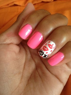 """<p>In case you're in a lovey dovey mood...</p> <p>Step 1: Apply a clear base coat to nails.<br />Step 2: Apply China Glaze, """"Flip Flop Fantasy"""" to all but the ring finger nail.<br />Step 3: Apply Sinful Colors, """"Snow Me White"""" on ring finger nail, and let dry.<br />Step 4: Using a nail dotting tool, found at any beauty supply store, draw lips and dot using Spoiled (by Wet and Wild), """"Lox-y-lady.""""<br />Step 5: Paint on XOXO with Jordana nail precision brush in black. <br />Step 6: Apply a clear top coat to nails.</p> <p> </p> <p>Submitted by Jacqueline</p>"""