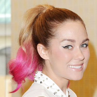 "From Katy Perry and Nicki Minaj's rotating cotton candy-colored [link ""cotton-candy colored"" to http://www.cosmopolitan.com/hairstyles-beauty/hair-care/pink-hair-celebrity-pictures] coiffures to Lauren Contrad's hot pink ponytail bright strands were <i>everywhere</i> in 2012. The salon trend spilled over to DIY with the advent of hair coloring chalk."