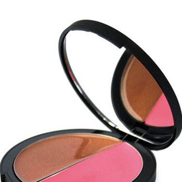 <p>Recreate your summery flush with this tried-and-true makeup artist trick: Blend a bronzey shade over cheekbones, followed by a sheer pink hue over apples of cheeks. This genius compact comes with both!</p>