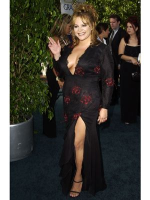 <p>We're guessing the whole Jennifer Lopez green Versace gown buzz still wasn't over in 2002. Every <em>chica</em> was rocking some form of the look, and Jenni was no exception with this low-cut black dress. <br /><br /></p>
