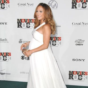"J. Lo and her twins (would it be too much to ask for TWO royal babies out of this one pregnancy?!) looked impeccable in well-draped white—which we already know is <a href=""http://www.cosmopolitan.com/celebrity/news/kate-middleton-royal-wedding-dress-042911"" target=""_blank"">an amazing color on the Duchess</a>."