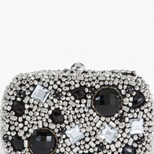 <p>When you need to touch up, a rhinestone clutch like this one will hold all your belongings without you looking like the bag lady, and it's super cute.</p>