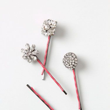 """<p>Add oomph to your holiday party 'do with flapper-style rhinestone and resin-embellished bobby pins. So lovely!</p><p>Stella Bobbies, $22, <a href=""""http://www.anthropologie.com/anthro/product/accessories-hair/25760307.jsp"""" target=""""_blank"""">anthropologie.com</a></p>"""