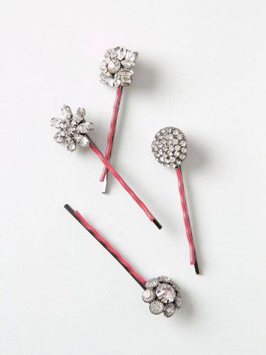 """<p>Add oomph to your holiday party 'do with flapper-style rhinestone and resin-embellished bobby pins. So lovely!</p>  <p>Stella Bobbies, $22, <a href=""""http://www.anthropologie.com/anthro/product/accessories-hair/25760307.jsp"""" target=""""_blank"""">anthropologie.com</a></p>"""