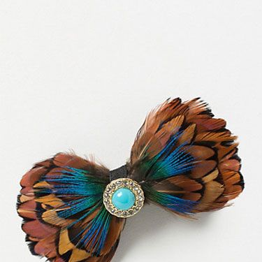 """<p>Unexpected and attention-getting, this turquoise-embellished feather barrette is the perfect thing to add personality to a LBD.</p><p>Jeweled Feather Clip, $18, <a href=""""http://www.anthropologie.com/anthro/product/26138206.jsp"""" target=""""_blank"""">anthropologie.com</a></p>"""