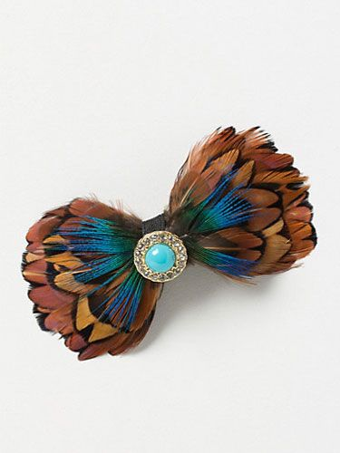 """<p>Unexpected and attention-getting, this turquoise-embellished feather barrette is the perfect thing to add personality to a LBD.</p>  <p>Jeweled Feather Clip, $18, <a href=""""http://www.anthropologie.com/anthro/product/26138206.jsp"""" target=""""_blank"""">anthropologie.com</a></p>"""
