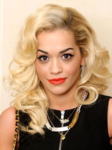 """The Brit singer picks up where Rihanna left off, adding a dash of Stefani and spiking the whole thing with retro Jayne Mansfield makeup (love the strong, filled-in brows and matte orange lips). Forget """"hot,"""" this new Roc-a-fella artist is the very definition of rock star sexitude."""