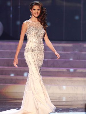 <p>Marie Payet's dress was a little more conservative but elegant. We loved the long, ruffle, train at the bottom.</p>