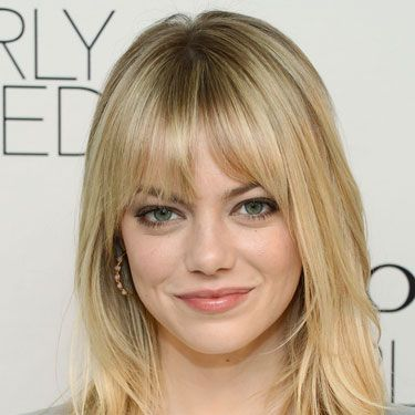 With her eyelash-grazing bangs, bright blonde layers, and chocolate eye liner (who knew?), Hollywood's favorite It girl struck the perfect balance between wildly seductive and easy-breezy at a recent Revlon event.