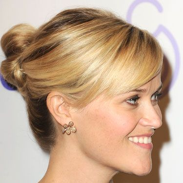 "Okay, we're living for the Oscar winner's gold-streaked bun and side-swept bangs at a recent March of Dimes event. It's so very ""buttoned-up schoolteacher who's actually a wild woman."""