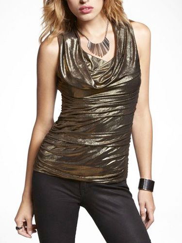 """Perfect for a night out, pair this top with a pair of sexy dark washed skinny jeans.<br /><br />  Metallic Draped Ruched Shell Top, $20, <a href=""""http://www.express.com/metallic-draped-ruched-shell-top-52430-43/index.pro?csename=Shopping.com&cid=1075&mr:referralID=8839b18e-508d-11e2-97b3-001b2166becc"""" target=""""_blank"""">express.com</a>"""