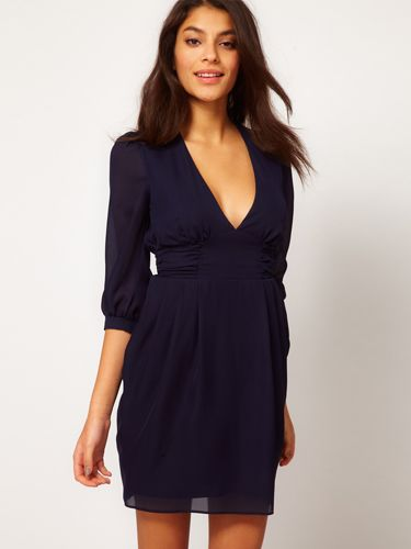 """Slim your waistline and call attention to your best assets in this low-cut dress.<br /><br />   Tulip Dress With Ruched Waistband, $62, <a href=""""http://www.asos.com/ASOS/ASOS-Tulip-Dress-With-Ruched-Waistband/Prod/pgeproduct.aspx?iid=2580865&SearchQuery=ruched&sh=0&pge=0&pgesize=-1&sort=-1&clr=Navy"""" target=""""_blank"""">asos.com</a>"""