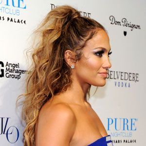 "<p>The classic Newyorican look—Jennifer Lopez's half up style—is simple. Apply a light mousse like <a href=""http://www.garnierusa.com/_en/_us/home.aspx"" target=""_blank"">Garnier Fructis Hydra Recharge Moisture Whip Leave-In Conditioner</a>. Part your hair in half, leaving about an inch strand from the top section out. Pull the top section into a high ponytail, then wrap the remaining strand around it. Lightly spray your hair with your favorite hairspray. <br /><br /></p>"