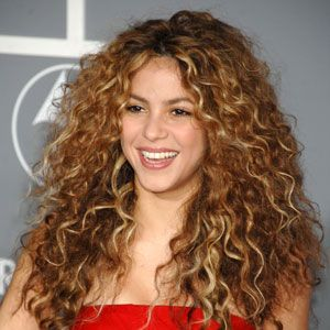 "<p>We miss Shakira's rocker days. This style is simple: no part, just let your hair air dry, and show off your long, tight curls. To prevent frizz, apply <a href=""http://www.ulta.com/ulta/browse/productDetail.jsp?productId=xlsImpprod4950041&skuId=2255107"" target=""_blank"">L'Oreal Smooth Intense Frizz Taming Serum</a>. <br /><br /></p>"