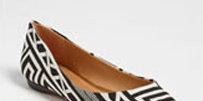 """<p>The black and white trends are already rolling in this year and we are so excited to see what's to come. This geometric shoe offers a new take on traditional black and white, pair with colored jeans to add a really cool contrast.</p> <p><a title=""""Black and White flat"""" href=""""http://shop.nordstrom.com/s/schutz-grifyn-flat/3433540?origin=category&contextualcategoryid=0&fashionColor=&resultback=0%20"""" target=""""_blank"""">$154.95</a></p>"""