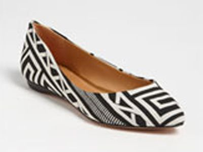 "<p>The black and white trends are already rolling in this year and we are so excited to see what's to come. This geometric shoe offers a new take on traditional black and white, pair with colored jeans to add a really cool contrast.</p> <p><a title=""Black and White flat"" href=""http://shop.nordstrom.com/s/schutz-grifyn-flat/3433540?origin=category&contextualcategoryid=0&fashionColor=&resultback=0%20"" target=""_blank"">$154.95</a></p>"