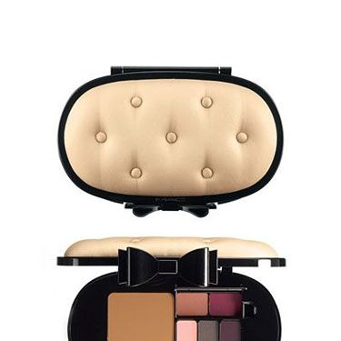 <p>Flaunt this luxe compact on your vanity and indulge in the goodies inside, which include a sparkly bronzing powder, smoky chic shadows and burgundy lipstick.</p> 