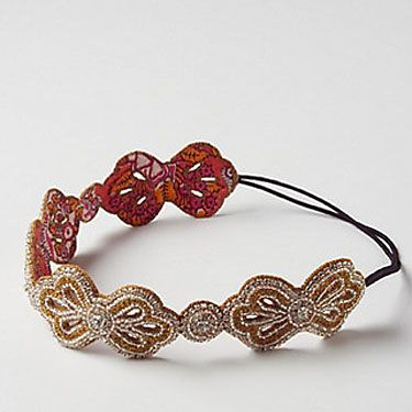 Sock buns are everywhere right now, and yours will look perfect with a sparkly bow headband.