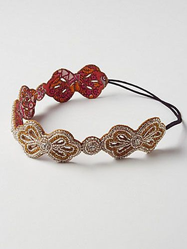 """Sock buns are everywhere right now, and yours will look perfect with a sparkly bow headband. <br /><br /> Beaded bow headband, $32, <a href=""""http://www.anthropologie.com/anthro/product/accessories-hair/26307702.jsp"""" target=""""_blank"""">Anthropologie.com </a>"""