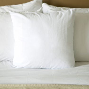 Simple, basic bedding in black, tan, or white indicates that he's uncomplicated and direct. You may not be having contortionist-style sex on those vanilla-hued sheets, but at least you'll never have to wonder what's on his mind.