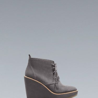 Rubber-soled wedges are just about the cutest and easiest things to walk in all winter long. These look adorable with skinny jeans and a chunky sweater. Plus, they're $30(!).