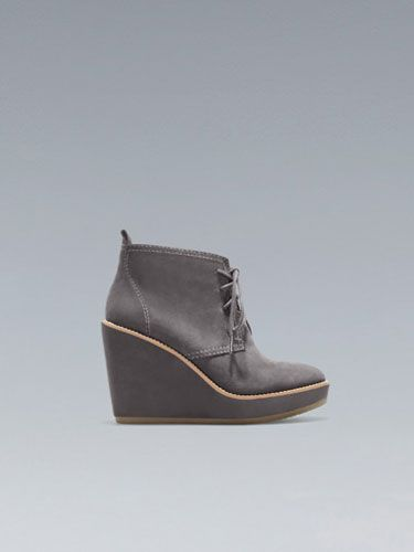 "Rubber-soled wedges are just about the cutest and easiest things to walk in all winter long. These look adorable with skinny jeans and a chunky sweater. Plus, they're $30(!). <br></br> Zara wedge lace-up ankle boot, $29.99,  <a href=""http://www.zara.com/webapp/wcs/stores/servlet/product/us/en/zara-us-W2012-s/332002/989026/WEDGE%20LACE-UP%20ANKLE%20BOOT"" target=""_blank"">zara.com</a>"