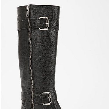 You can't go wrong with a heavy-duty motorcycle boot over tights with a sweet, girlie dress. 