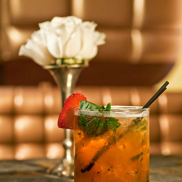 <i>1½ oz. citron vodka<br />½ oz. peach liqueur<br />¼ oz. apple liqueur<br />¼ oz. simple syrup<br />¼ oz. lime juice<br />1 strawberry<br />5 basil leaves<br />Garnish: strawberry</i><br /><br /> To make simple syrup, mix equal parts hot water and sugar until sugar is dissolved. Muddle the strawberry and basil leaves in a cocktail shaker. Add remaining ingredients. Shake and serve in a glass filled with ice. Garnish with a strawberry.<br /><br /><i>Source: LAVO NYC</i>