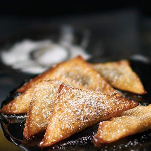 <p>1 medium banana, peeled and cut into chucks<br />1/4 cup light brown sugar<br />1/3 cup roasted and shelled pistachio nuts, finely chopped <br />2 tbsp. Simple Indulgence Chocolate Dessert Blend<br />1 tbsp. low-fat sour cream<br />2 tbsp. mascarpone cheese<br />24 refrigerated wonton wrappers<br />1 egg, beaten<br />2 cups canola oil</p><p>Combine banana and brown sugar in a small bowl. In another small bowl, combine pistachio nuts, dessert bleen, sour cream, and mascarpone cheese. Place about a teaspoon of each mixture in center of wonton. Brush wonton with beaten egg and fold wonton diagonally to form a triangle. </p><p>Press edges together firmly to seal. Heat oil in a frying pan over medium heat to 375° F/190°C. Place raviolis in pan one at a time and try until golden.Remove with a slotted spoon and drain on paper towels. Sprinkle with desssert blend or powdered sugar, if desired. Cool 2 mintues. Serve warm.  </p>