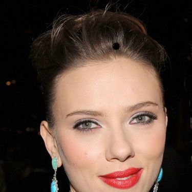 At the Broadway premiere of <i>Cat on a Hot Tin Roof</i>, ScarJo reminds us why she's our boyfriend's favorite pinup. We're living for the silver shadow/matte rosy-red lipstick combo.