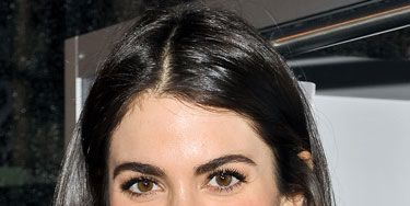 We've been slow to embrace the full-on '80s brow, but the <i>Twilight</i> actress' full arches (left, at a Times Square event) are convincing us otherwise. So chic! And the persimmon pucker is first date-spectacular.