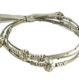 "<div style=""margin: 0pt&#x3B;""><span style=""font-family: Times New Roman&#x3B; font-size: medium&#x3B;""><span style=""font-size: 12pt&#x3B;"">This bracelet with floral accents is the right size, not too thick like most. The dainty set comes with four tied by a ribbon in both silver and turquoise. </span></span></div>