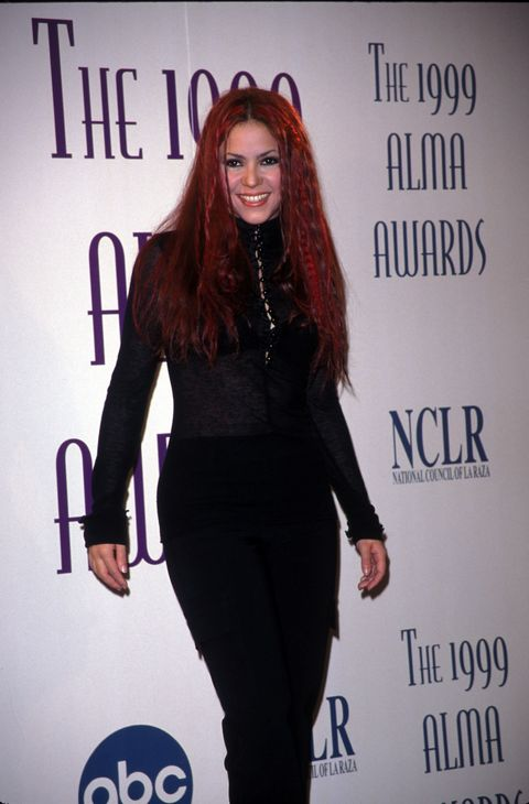 This is the Shakira we all know and love, a red haired <em>rockera</em> that didn't have to glam up to look good. Her all black ensemble speaks volumes of her style back then.
