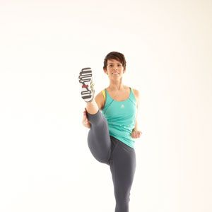 <p>Slightly bend your knees in the horse straddle position. Pull arms backward at your side with fists facing up.</p>