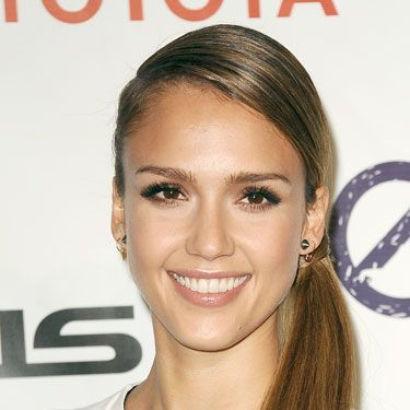 We live for the sexy drama of Jessica Alba's sleeker-than-sleek, low side-pony. Just the thing with a bold, graphic top.