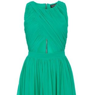 <p>This dress really catches your eye with its bold color. The mesh overlays are great to offer an appearance of a risky mid section while the gathered waist hugs your tiny curves. The back zipper also adds a little edge. It comes in white and purple as well</p>