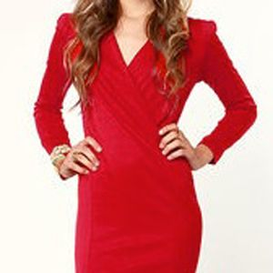 <p>Obvi for Valentine's Day you need a little red and with this dress we do mean little. This knit dress comes with lightly padded shoulders that give you that vamp factor and the v-neck offers you the option to show off the goods or not.</p>