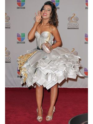 <p>We're guessing she made a paper mache dress out of all the newspaper articles chronicling her terrible fashion.</p>