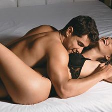 """<p>Tones: Butt and Abs</p><p>Pulled from Cosmo's sex positions page, this form of missionary is classic with a little edge. </p><p><a href=""""http://www.cosmopolitan.com/sex-love/tips-moves/sex-positions-that-help-women-orgasm#slide-1"""" target=""""_blank"""">Figure Eight</a>: While lying on the floor, use two pillows to prop your butt up and keep your knees slightly bent. Have him enter you, and keep your nalgas and core tight. Bonus: Remove the pillows and hold yourself to feel the extra burn.</p>"""
