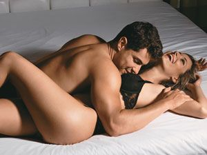 """<p>Tones: Butt and Abs</p> <p>Pulled from Cosmo's sex positions page, this form of missionary is classic with a little edge. </p> <p><a href=""""http://www.cosmopolitan.com/sex-love/tips-moves/sex-positions-that-help-women-orgasm#slide-1"""" target=""""_blank"""">Figure Eight</a>: While lying on the floor, use two pillows to prop your butt up and keep your knees slightly bent. Have him enter you, and keep your nalgas and core tight. Bonus: Remove the pillows and hold yourself to feel the extra burn.</p>"""