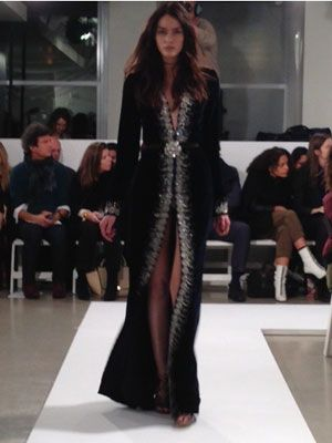 <p>So sexy! This coat dress with a plunging neckline and  thigh-slit will make an entrance and show some serious skin. The crystal detailing screams luxury.<br /><br /></p>