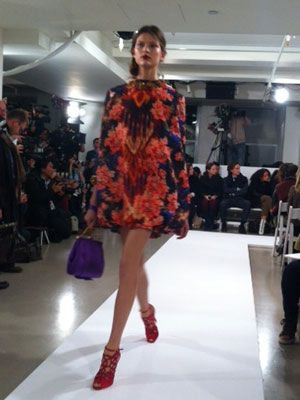 <p>A balloon mini dress in a fierce floral-esq pattern that's perfect for the downtown girl. With red cut-out booties, it's a head-turner.</p>