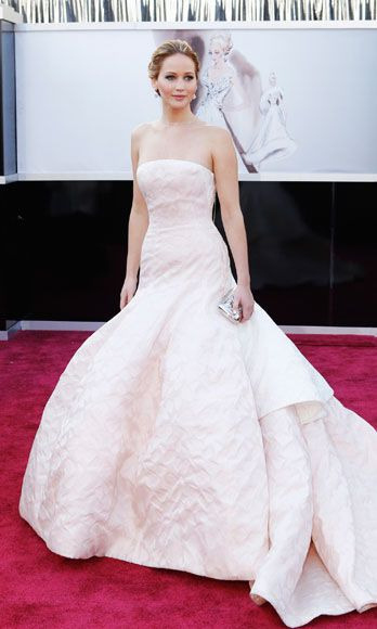 """<p>J-Law has made it pretty clear she doesn't stick to the Hollywood playbook (silver linings or otherwise.) She doesn't really want to talk about her stunning Dior gown (At the Oscars: """"What do you mean? This is the top, and this is the bottom.""""), she's all but said she hates doing interviews, and <a href=""""http://www.cosmopolitan.com/celebrity/news/jennifer-lawrence-silver-linings-playbook-premiere"""" target=""""_blank"""">she's even worn a tux</a>to her own movie premiere. Defining your own """"norm"""" proves you're comfortable with who you are and who you aren't—like it or not.</p>"""