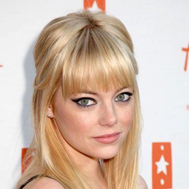 Emma Stone looks like hot sex on a platter! To do, simply tease your roots at the crown, sweep the top and sides of your hair back into an elastic, and leave bangs loose. Pair with major cat eyes, and he's yours.