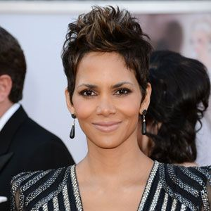 "<p>Halle Berry aced her red carpet look with a soft smokey eye, pinch-me pink cheeks and nude lips. Kara Yoshimoto Bua, the CHANEL Celebrity Makeup Artist who created Halle's look, breaks down how to get it: Start by moisturizing skin with <a href=""http://www.google.com/url?q=http://www.chanel.com/en_US/fragrance-beauty/Skincare-Moisturizers-SUBLIMAGE--119596&sa=U&ei=g78rUYzqOYji0QHd34CIBw&ved=0CDMQFjAA&sig2=ooF89dx7I3T0kEjR8ToPqQ&usg=AFQjCNEWYtBGgTB1bCK7M0l3A5I5NdfkGw"" target=""_blank"">CHANEL Sublimage La Creme Texture Supreme</a>, and apply <a href=""http://www.walmart.com/ip/21129534?wmlspartner=wlpa&adid=22222222227000000000&wl0=&wl1=g&wl2=&wl3=21486607510&wl4=&wl5=pla&veh=sem"" target=""_blank"">REVLON PhotoReady Perfecting Primer.</a> Apply <a href=""http://www.ulta.com/ulta/browse/productDetail.jsp?skuId=2246985&productId=xlsImpprod4410265&navAction=push&navCount=1&categoryId=cat80022?cmpid=PSGO&CAWELAID=1381239020&catargetid=1542183334&cagpspn=pla"" target=""_blank"">REVLON ColorStay Whipped Crème Mousse Makeup</a> (Halle's wearing Caramel), to even out skin tone. Swipe cheeks with <a href=""http://www.amazon.com/CHANEL-powder-blush-FRIVOLE-spring/dp/B00APT0ILM"" target=""_blank"">CHANEL Powder Blush in 76 Frivole</a>, to create a soft pink flush. Add <a href=""http://soniakashuk.com/blog/?tag=chic-luminosity-stick-in-sparkling-sands"" target=""_blank"">Sonia Kashuk Chic Luminosity Highlighter Stick in Sparkling Sands </a>to highlight cheekbones. Prime eyes with <a href=""http://www.google.com/aclk?sa=l&ai=CZHGqN8ArUbOwFLGh6QGl2IGwBJ6yiasD3pD0v0muxY7OhwEIBRABILZUKANQ-c7k4_n_____AWDJxqmLwKTYD6AB_tis-wPIAQeqBCRP0MqDUfzc2J2VNETECtcA04rFBHjfpu7gf2vwL1wPqVyEdGCABZBOwAUFoAYmgAfqptME4BLLnKzFmbKA5hU&sig=AOD64_31FnNB4uZHTFtBuFhQD2tmrpvqBg&ctype=5&ved=0CCIQww8&adurl=http://ad.doubleclick.net/clk%3B207169236%3B29429970%3Br%3Fhttp://www.ulta.com/ulta/browse/productDetail.jsp%3FskuId%3D2240012%26productId%3DxlsImpprod4040057%26navAction%3Dpush%26navCount%3D1%26categoryId%3Dcat40006%3Fcmpid%3DPSGO%26CAWELAID%3D1151381069%26catargetid%3D1542183334%26cagpspn%3Dpla"" target=""_blank"">REVLON PhotoReady Eye Primer + Brightener</a>, then use REVLON PhotoReady Primer + Shadow in Graffiti all over lids. Add REVLON PhotoReady Primer + Shadow in Metropolitan for a coat of sparkle under the eyes.</p>