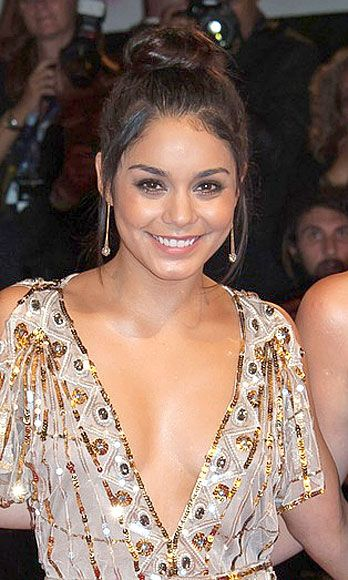 "Guys love the ""effortlessly gorgeous"" look (they don't have to know we spent twenty minutes creating said look). At the <i>Spring Breakers</i> premiere, Vanessa embodied casual hotness with a haphazard topknot, low-key neutral lip and mascara."