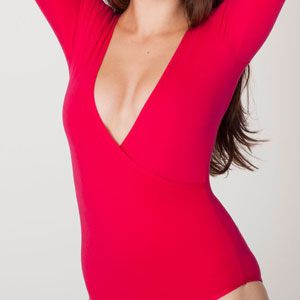 """<p>There's a reason why men drool over <em>mujeres</em> like Beyonce when she rocks her signature body suit. These days, all women own a basic one and it's super sexy.</p><p>$36, <a href=""""http://store.americanapparel.net/product/?productId=rsa8328"""" target=""""_blank"""">American Apparel</a></p>"""