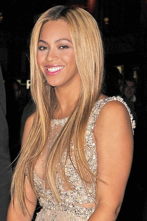 <p>Although Beyoncé is a hairstyle cameleon, we love her in stunning stick-straight hair. Plus, lucky for us, her look is super easy to achieve at home&#151;all you need is a smoothing cream, a heat protectant spray, and a flat iron.</p>